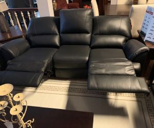Elran power reclining black leather sofa